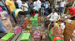 New Delhi: People buying fire-crackers near Jama Masjid in old Delhi on Monday. The Supreme Court has banned the sale of firecrackers in Delhi till November 1. PTI Photo by Vijay Verma (STORY DEL42)(PTI10_9_2017_000197B)